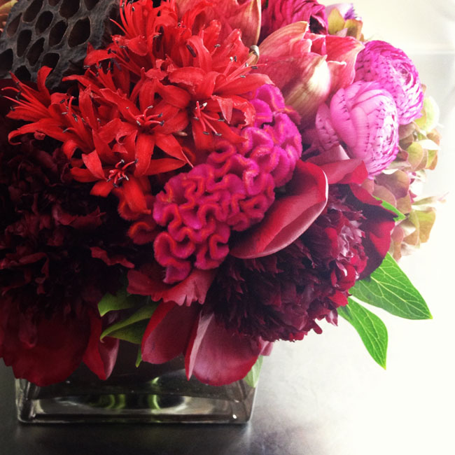 Cymbidium Flower Shop, New Hampshire - flower centerpiece of red coxcomb, red peonies, nerines, lotus pods