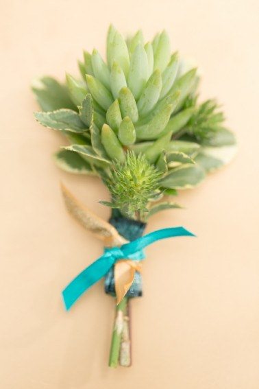 Garden Gate Florals - Succulent Oregonia Varigated Green Thistle Teal, gold and dark teal ribbon tied. $18.00