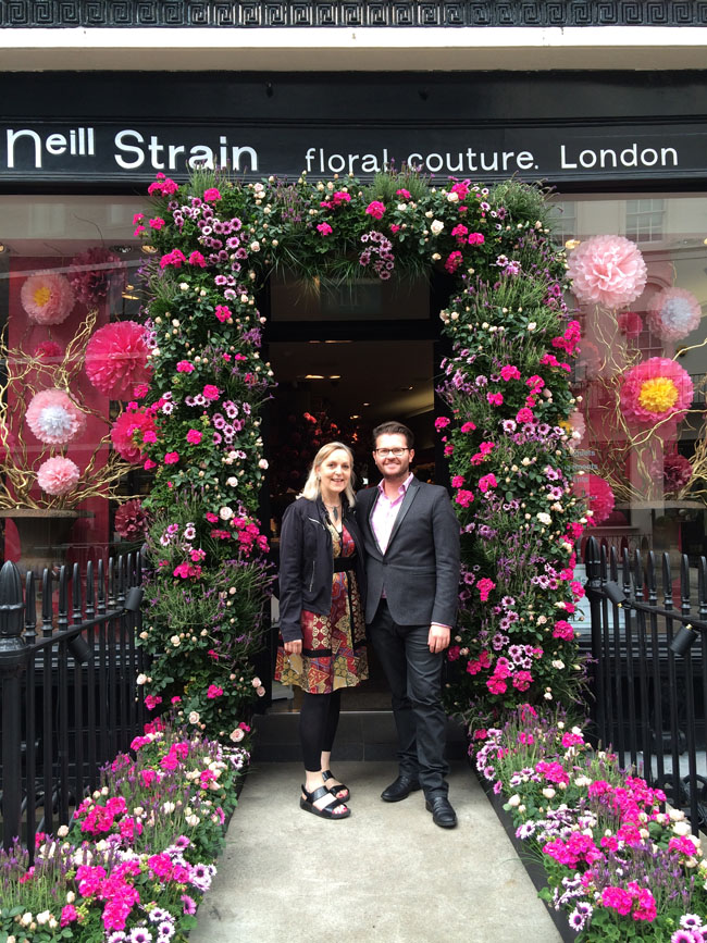 Paula Pryke and Neill Strain in front of his shop in London