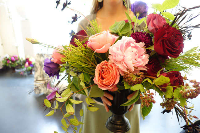 Colleen of Botanikal showing her floral centerpiece