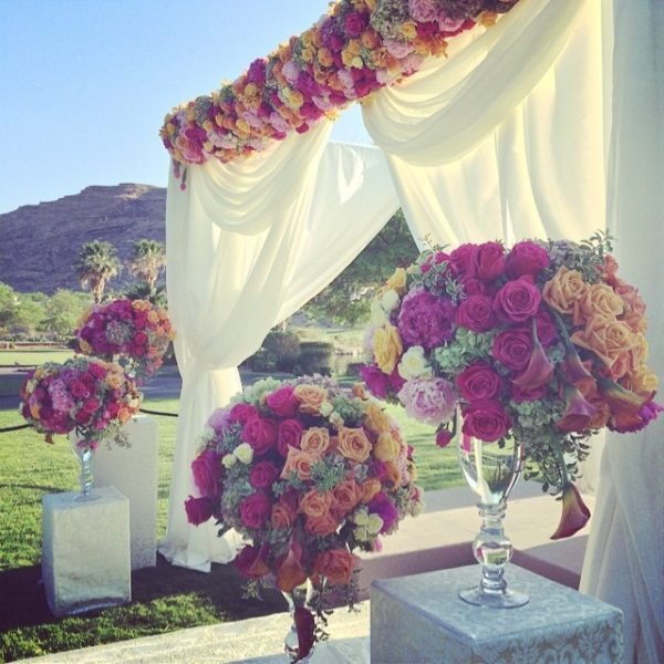 Adorations Botanical Artistry, Ceremony Arch with large floral arrangements