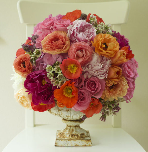 Bella Fiori, Garden urn filled with orange poppies, pink roses, pink peonies, orange and peach ranunculus, allium