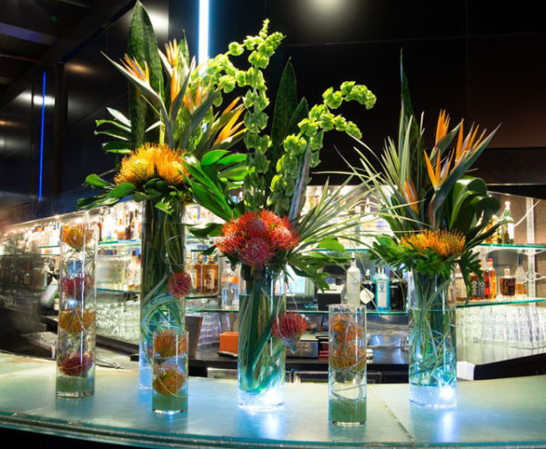 Kristina Bumphrey Photography, The Arrangement NYC, Orange pincushion proteas, birds of paradise, bells of Ireland.