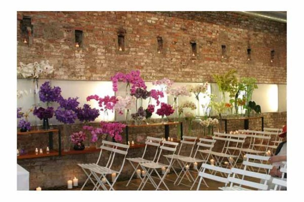 Marcey Brownstein Catering, Vases filled with orchids decorate the ceremony space