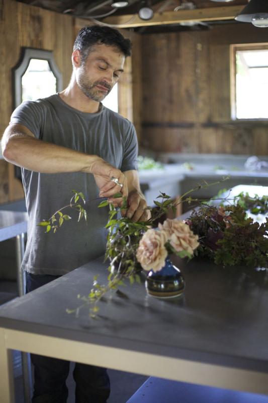 Max Gill Designing in his studio