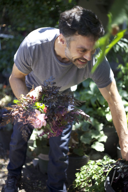 Max Gill gathering foliages from his cutting garden