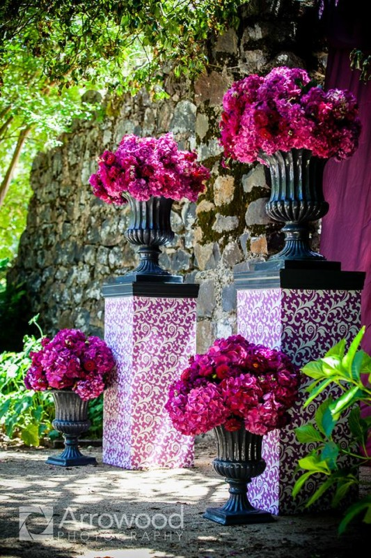 Michael Daigian Design, Black urns filled with hot pink flowers for the ceremony decor