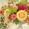 Bella Fiori, peach and pink floral arrangement with honeysuckle, dahlias, garden roses, dahlias
