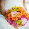 Bridal bouquet of pink hydrangeas, pink roses, green cymbidiums, orange roses and pink dahlias
