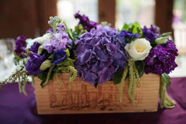 Bella Fiori, Wine box centerpiece filled with purple, white and green flowers
