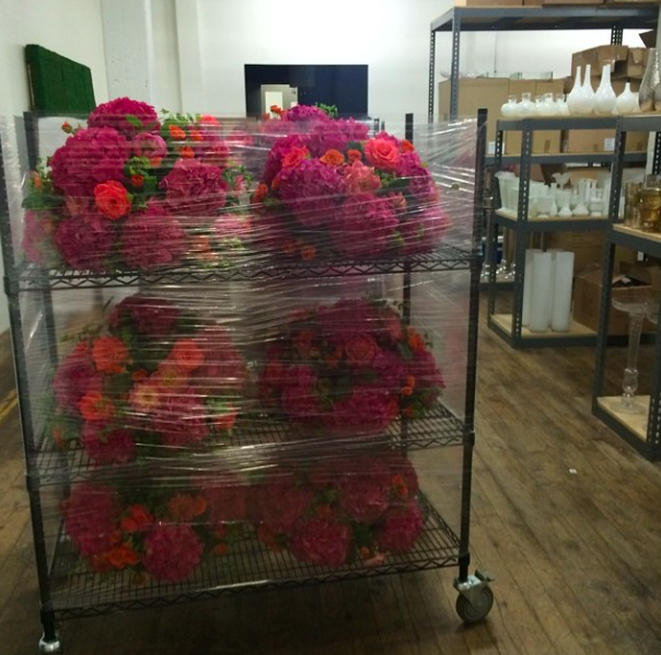 flowers loaded on rolling carts