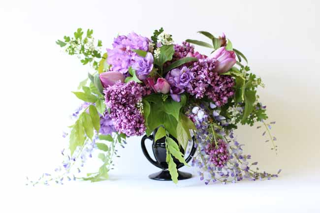 Spring centerpiece, with wisteria, tulips, azalea and hawthorne by Flora Organica Designs