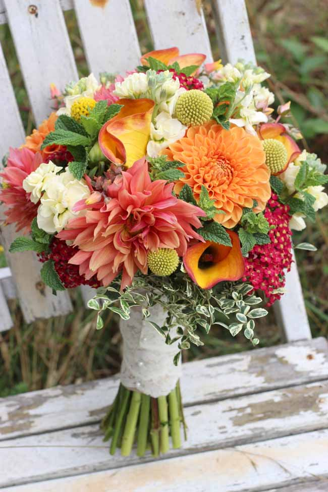 summer bouquet with organic dahlias, craspedia, mint, stock, yarrow
