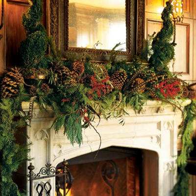 Holiday fireplace mantle decorated with greeneries