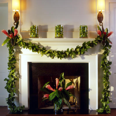 greenery garland decorating the fireplace mantle
