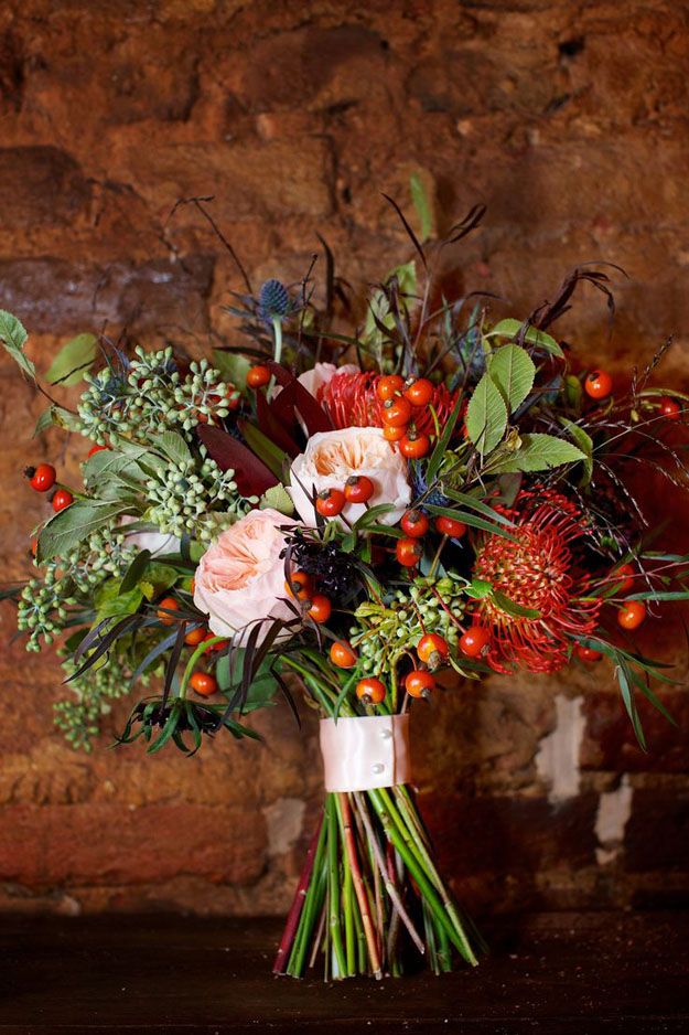 Crimson and Clover Floral Design - textured bridal bouquet with roses, pincushions, rose hips and seeded eucalyptus