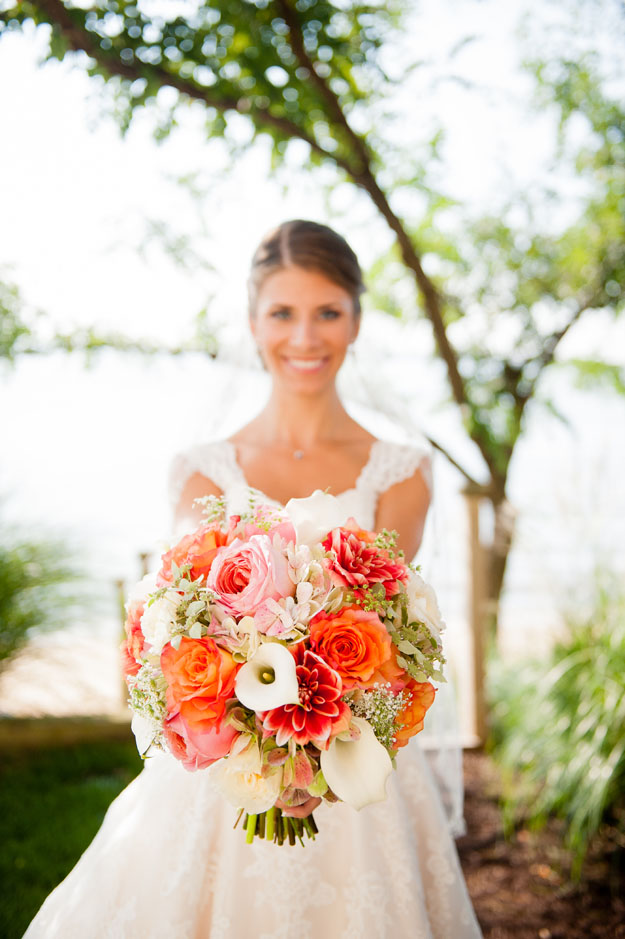 Crimson and Clover Floral Design -  orange, peach and cream bridal bouquet