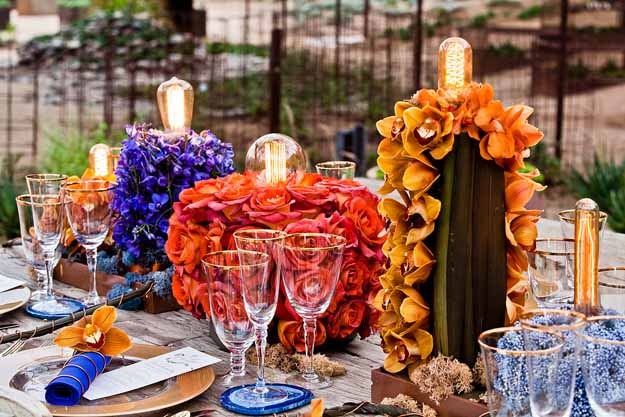 Flower Bar = orange, copper and delphinium centerpiece