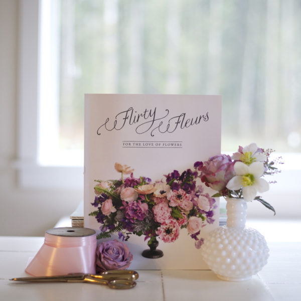 Flirty Fleurs Print Magazine for Floral Designers, floral arrangement on the cover is designed by Janet Martineau of Floral Verde.
