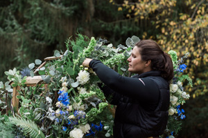 Amy from Gather designing a floral arch