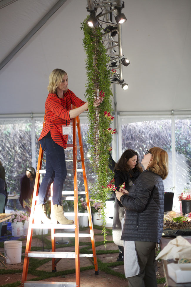 Florabundance Design Days 2016 - Katie Noonan AIFD adding gloriosa to the floral backdrop