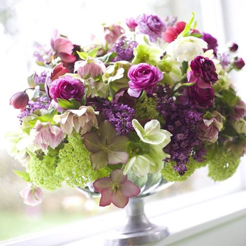 Bella Fiori, Seattle Washington - Floral Design in a silver compote with lilacs, hellebores, viburnum and ranunculus
