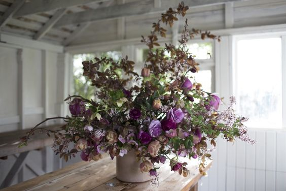 Tulip 'La Belle Epoque', Ranunculus, Plum foliage and flowers, Hellebores, Akebia vine and Magnolia blossoms. Floral designer Floret