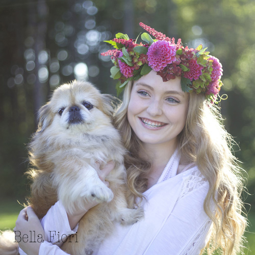 Bella Fiori wearing a flower wreath of dahlias, astilbe and hydrangea