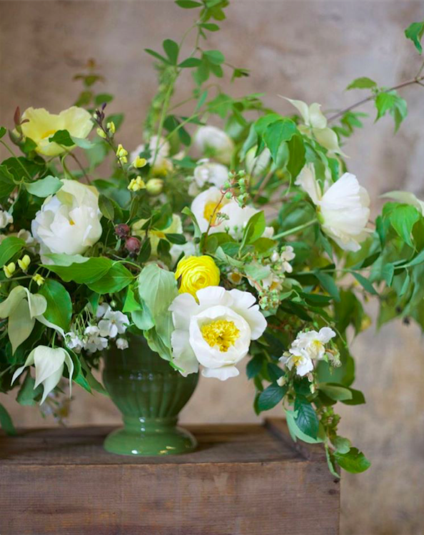 Botanique Flowers, Seattle, photographed by Alicia Schwede. Green urn filled with foliages, white and yellow flowers.