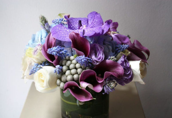 Rachel Cho Floral Design New York City - centerpiece of purple and grey flowers