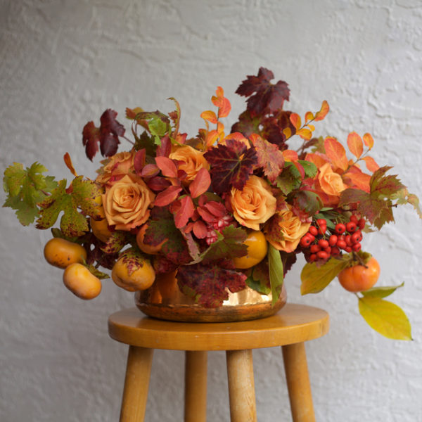 Bella Fiori - Autumn inspired orange arrangement with roses and persimmons