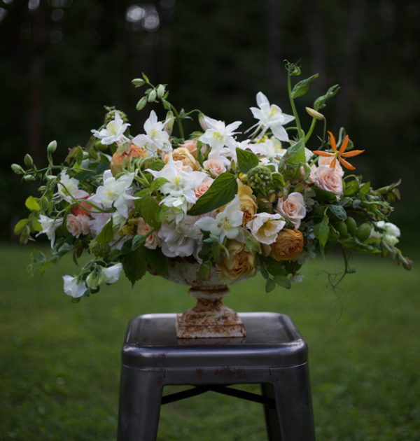 Bella Fiori - urn arrangement with peach and white flowers, including columbines.