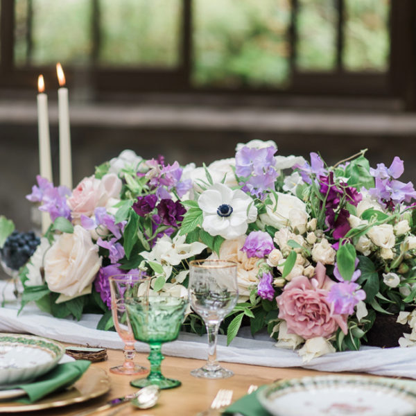 Bella Fiori - flower arrangement of purple and white flowers.