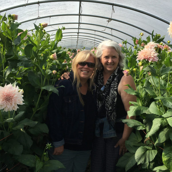 Alicia Schwede and Debra Prizing in the Cafe Au Lait Dahlia hoop house at Jello Mold Farm