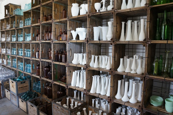 A LA CRATE Vintage Rentals - florist shelves filled with vases and containers