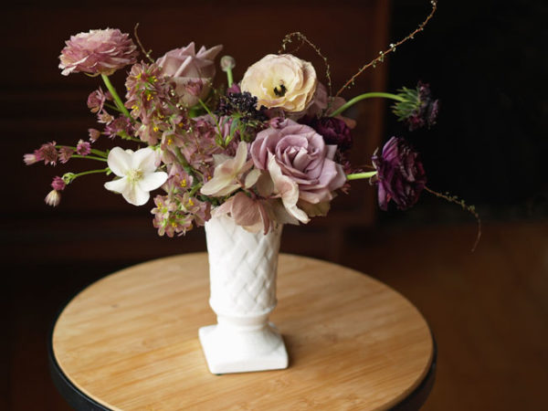 Amanda at Alluring Blooms, Wisconsin, milk glass with a lavender floral arrangement