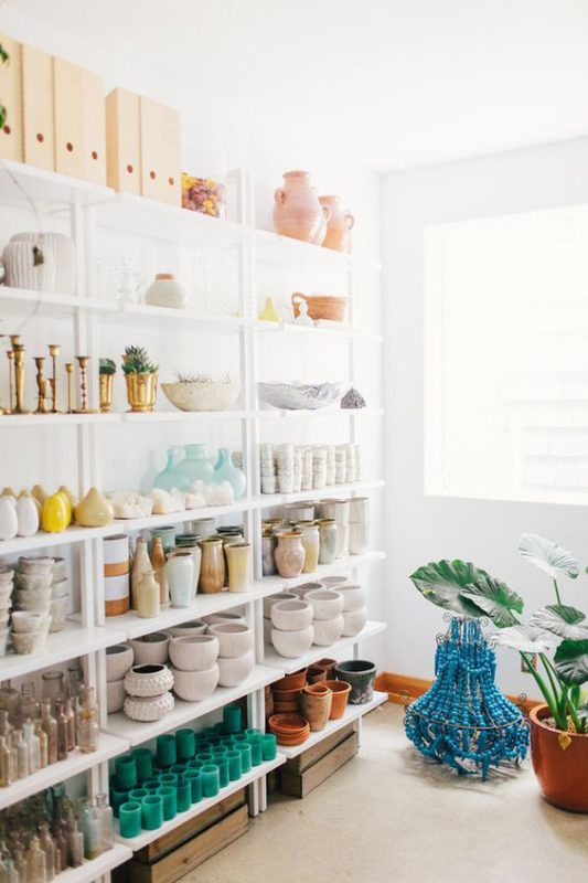Shotgun Floral Design Studio - florist shelves filled with vases and containers
