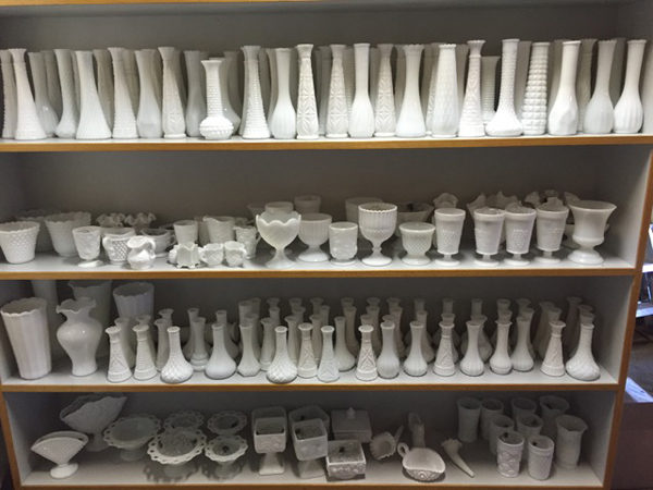 Verbena Floral Seattle - florist shelves filled with vases and containers