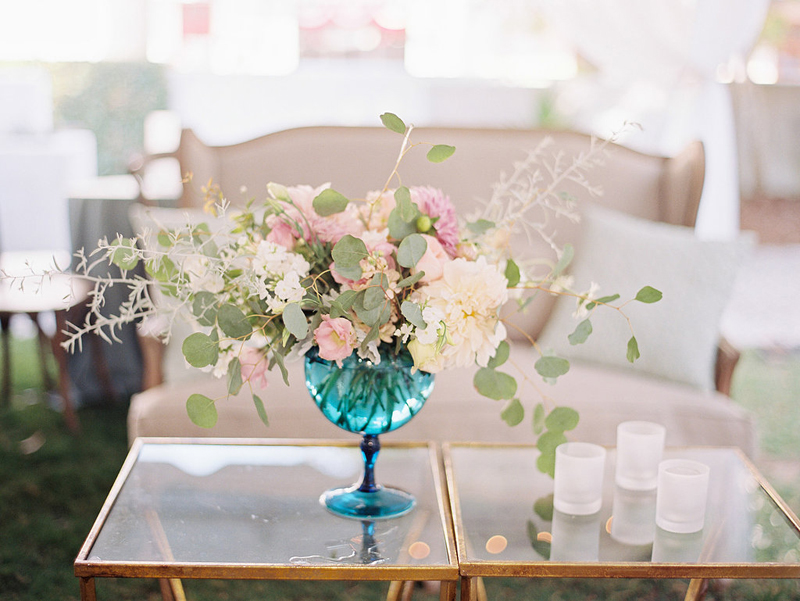 Myrtie Blues Floral Design, Florida. Flower centerpiece in a blue goblet. Lauren Kinsey Photography.