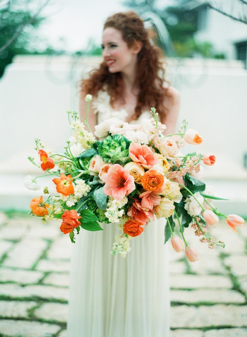 Myrtie Blues Floral Design, Florida. Lauren Kinsey Photography. Bridal Bouquet of orange and peach flowers.