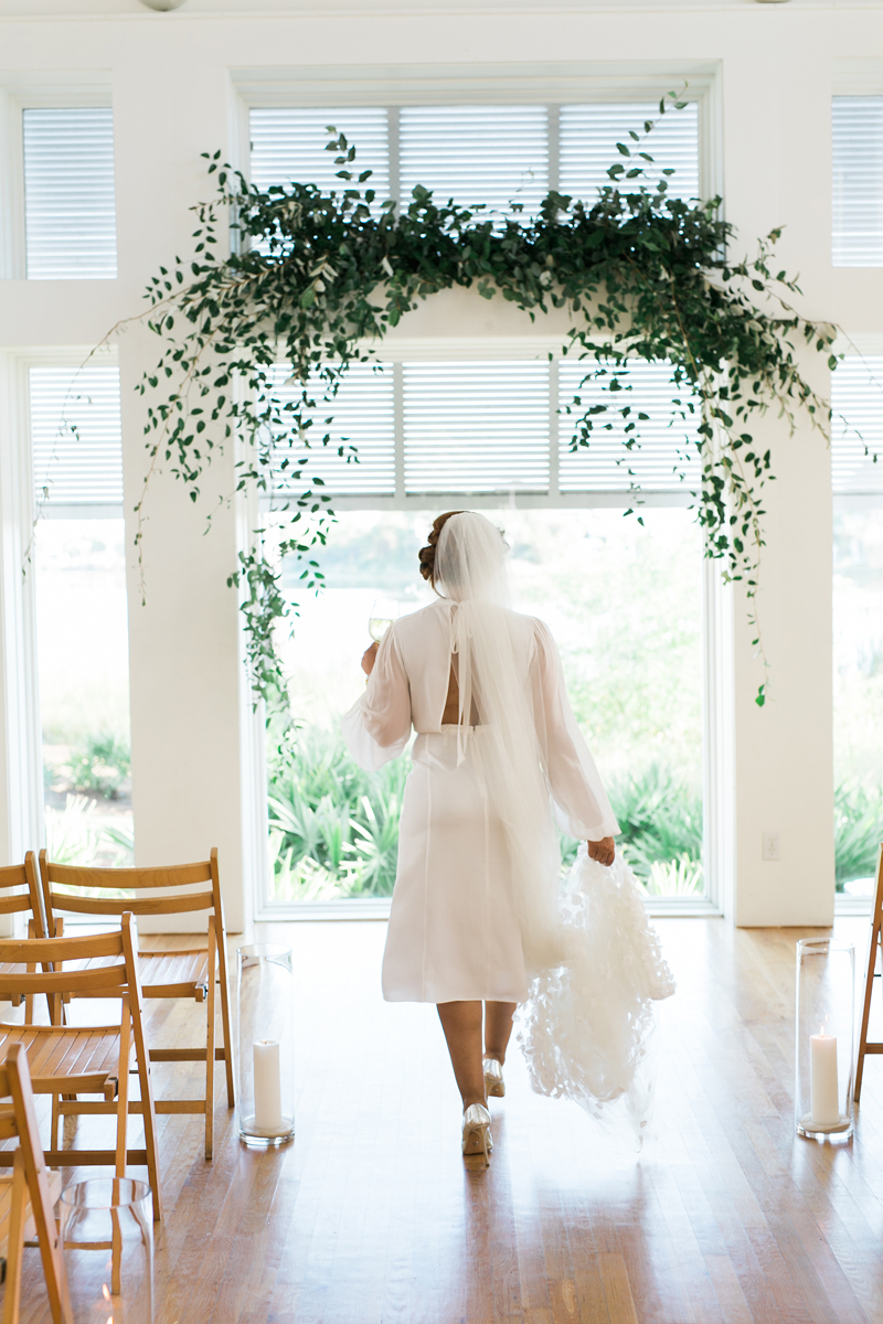 Myrtle Blue Floral Design, Florida. Shannon Griffin Photography. greenery flower arch for ceremony.