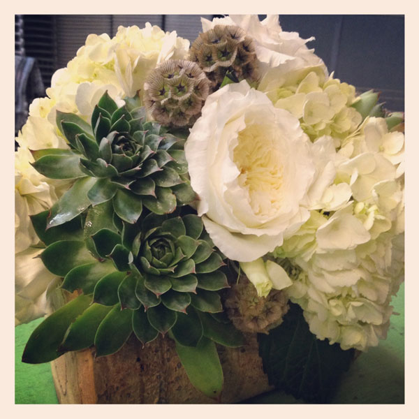 white roses, hydrangea succulents in wood base
