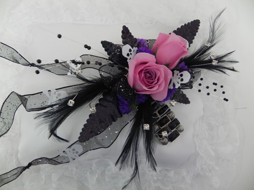 wristlet corsage with black and pink roses