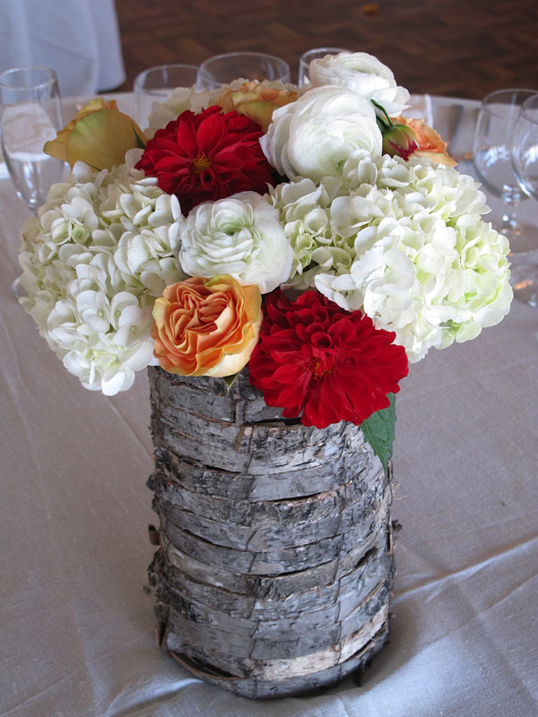 rustic centerpiece with white red and orange flowers