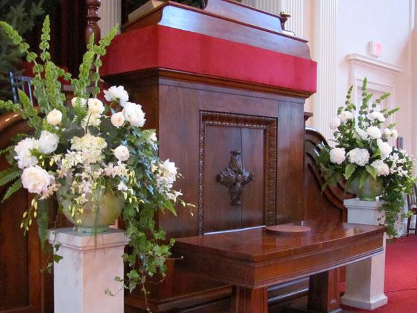 white flower arrangements on altar