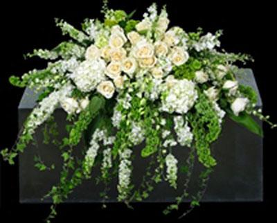 white flower casket spray