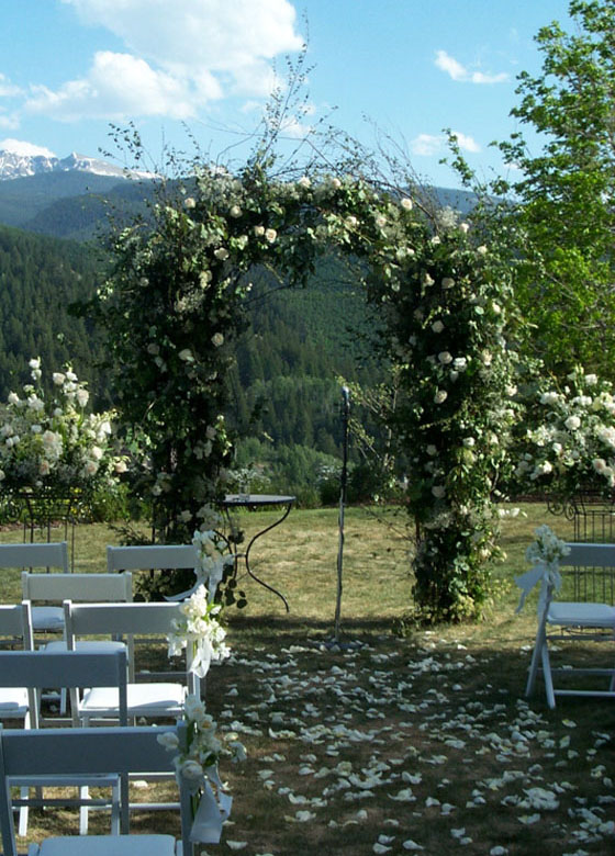 white and green wedding arch
