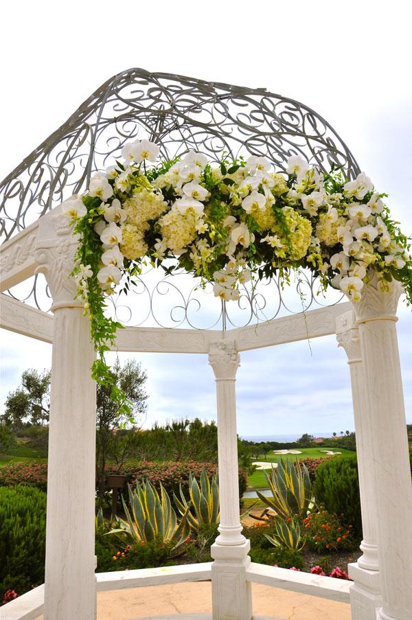 white flower archway