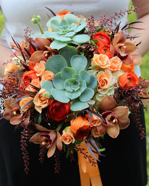 orange roses and orchids and succulent bouquet