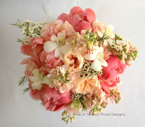 bouquet with peach and coral flowers